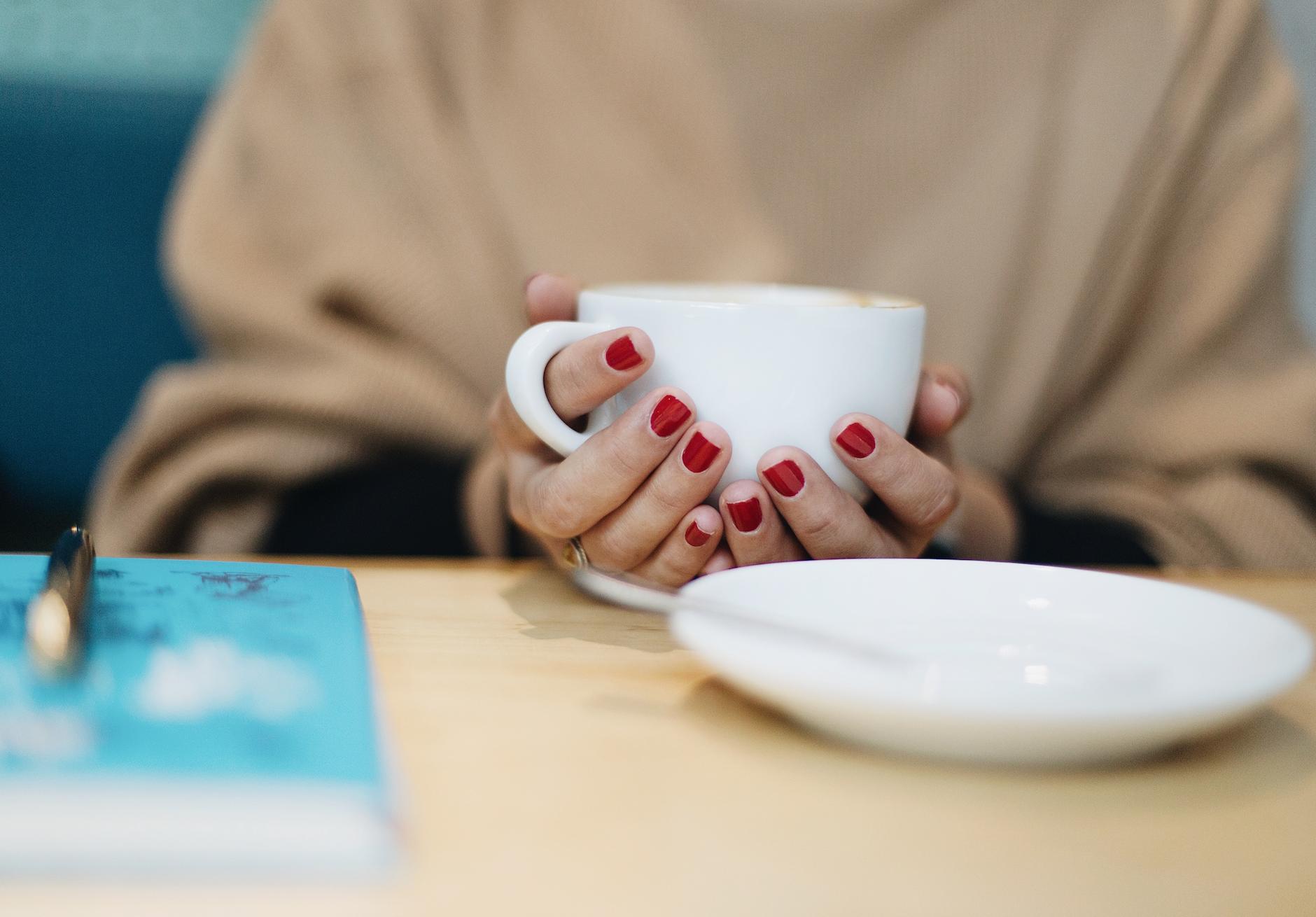 Sylwia holding coffee mug