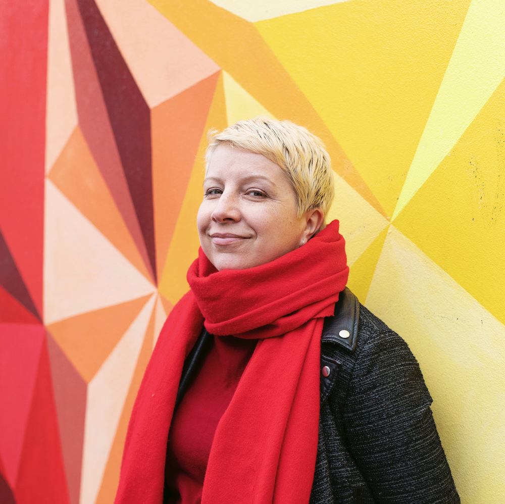 Sylwia with red and yellow mural