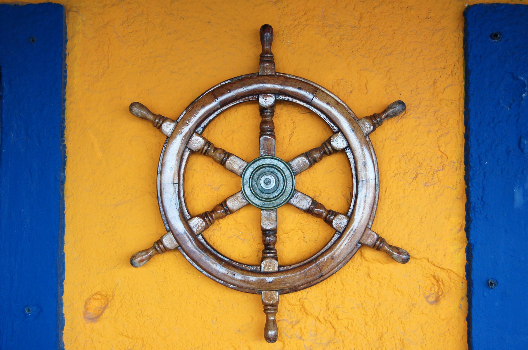 steering wheel on yellow and blue